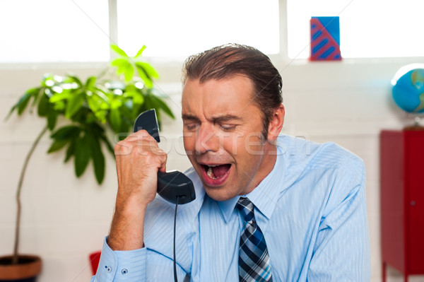 Businessman yelling during the phone call Stock photo © stockyimages