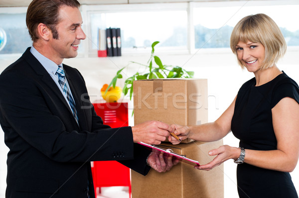 Kindly sign the business papers ma'am! Stock photo © stockyimages