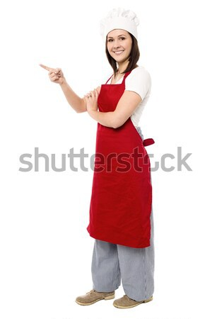Female chef pointing towards copy space area Stock photo © stockyimages