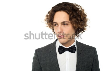Sullen faced serious young groom Stock photo © stockyimages