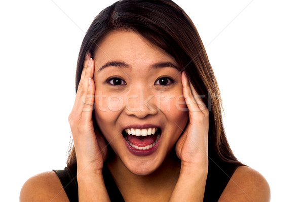 Shocking expression by a young girl Stock photo © stockyimages