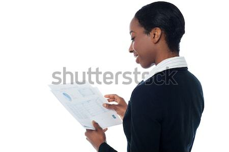 Employer reviewing annual report Stock photo © stockyimages