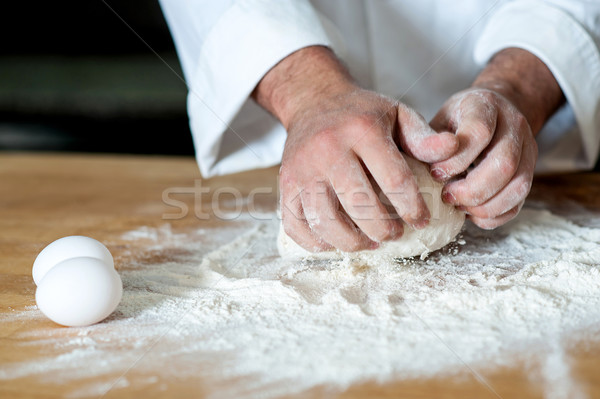 Man kneading dough, closeup shot Stock photo © stockyimages