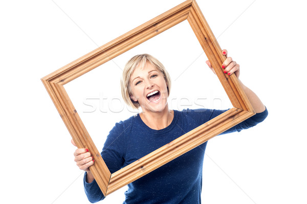 Excited woman enjoying, having a blast. Stock photo © stockyimages