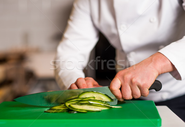 Chef chopping leek, doing preparations Stock photo © stockyimages