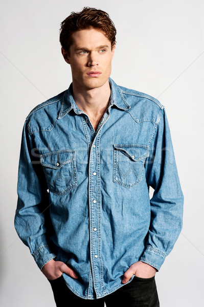 Handsome casual man posing to camera Stock photo © stockyimages