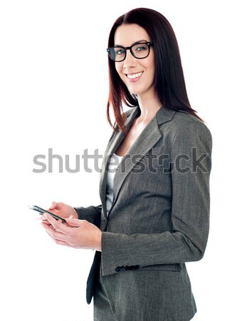 Işadamı mesajlaşma gülen kadın çalışmak zaman Stok fotoğraf © stockyimages