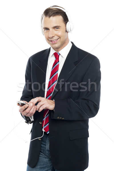 Relaxed business executive tuned into music Stock photo © stockyimages