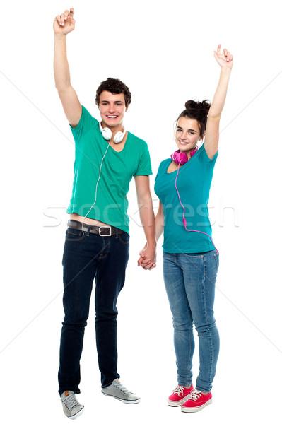 Strong bonding of cheerful teen couple enjoying music Stock photo © stockyimages