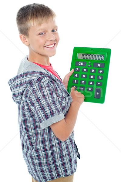Kellemes fiatal diák nagy zöld számológép Stock fotó © stockyimages