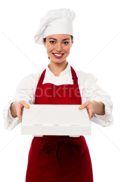Attractive asian female chef delivering pizza Stock photo © stockyimages
