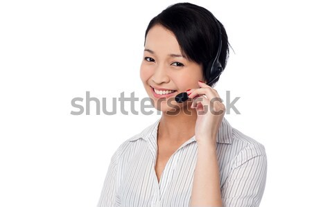 Smiling attractive call center executive  Stock photo © stockyimages