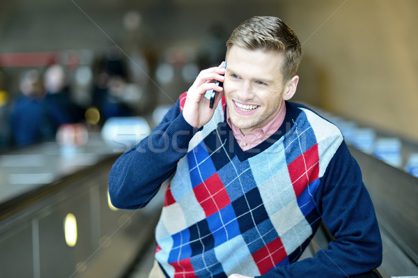 Handsome man communicating with friend Stock photo © stockyimages