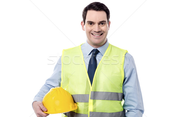 Smiling engineer with safety helmet Stock photo © stockyimages