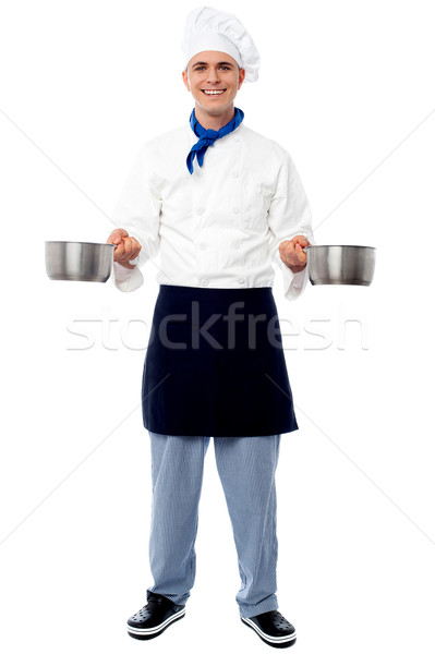 Stock photo: Young male chef holding empty vessels