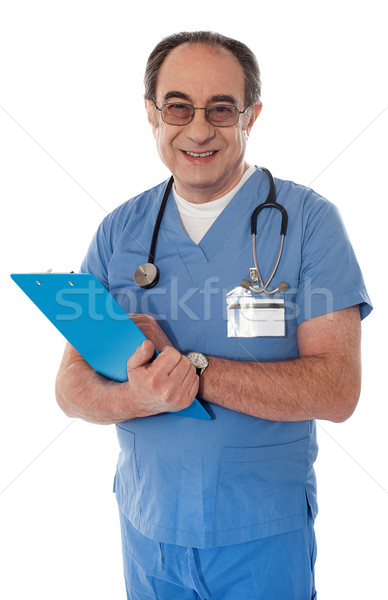 Experienced doctor smiling at camera Stock photo © stockyimages