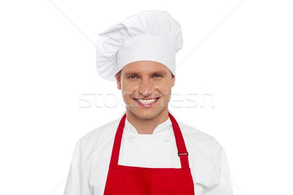 Halve lengte portret glimlachend mannelijke chef geïsoleerd Stockfoto © stockyimages