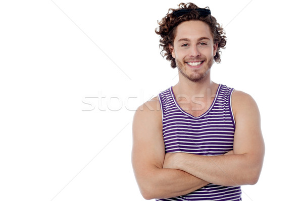 Smiling young guy posing casually Stock photo © stockyimages