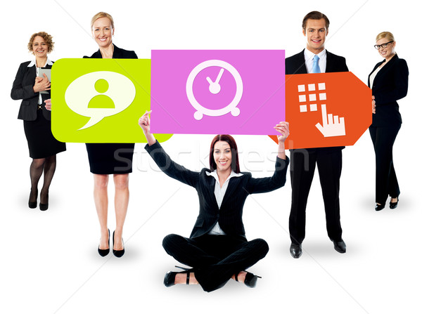 Business people holding colorful boards Stock photo © stockyimages