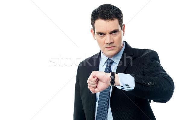 постоянно поздно служба сердиться бизнесмен глядя Сток-фото © stockyimages