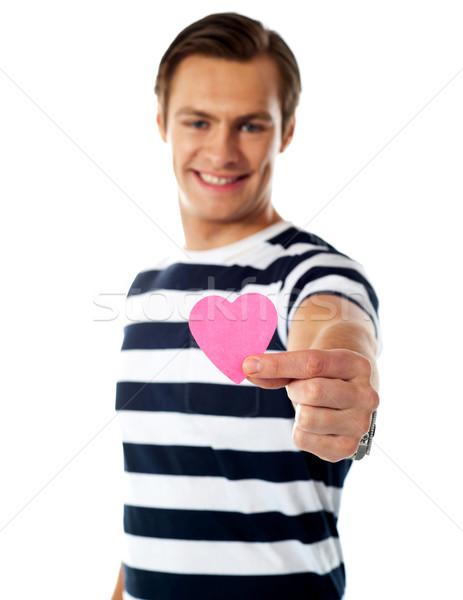 молодым человеком предлагающий бумаги сердце изолированный белый Сток-фото © stockyimages