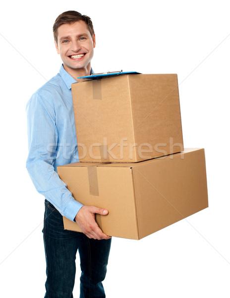 Amavelmente entrega caixas inteligente moço Foto stock © stockyimages