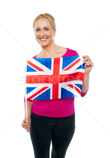 Cheerful female supporter holding national flag Stock photo © stockyimages