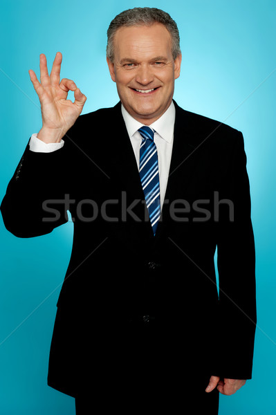 Experienced businessman showing okay sign Stock photo © stockyimages