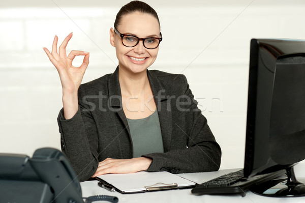 Corporate woman showing excellent gesture Stock photo © stockyimages