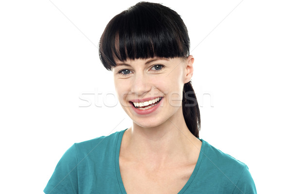 Charming young female flashing an impressive smile Stock photo © stockyimages