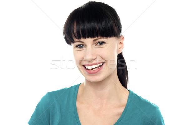 Encantador jovem feminino impressionante sorrir Foto stock © stockyimages