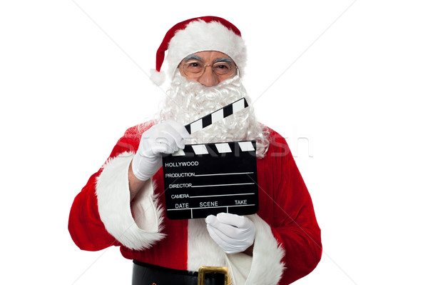 Cheerful aged Santa posing with a clapperboard Stock photo © stockyimages