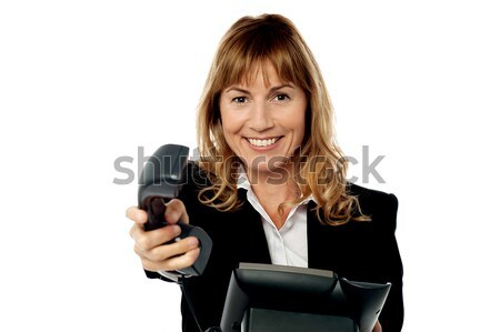 Sales executive displaying brand new multimedia phone Stock photo © stockyimages