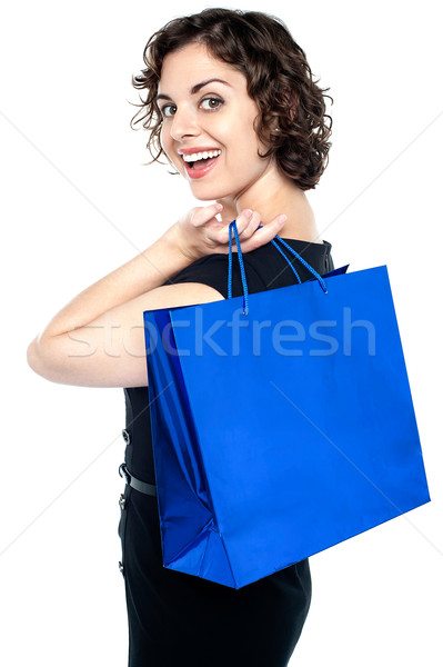Joyous woman posing with a shopping bag Stock photo © stockyimages