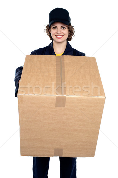 Good looking woman holding up a cardboard box Stock photo © stockyimages