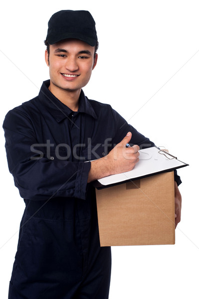Smiling delivery man at your doorstep Stock photo © stockyimages