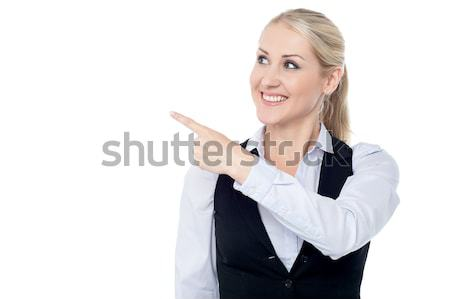 Stock photo: Lady pointing towards copy space area