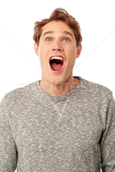 Erstaunt jungen guy öffnen Mund schockiert Stock foto © stockyimages