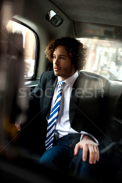 Handsome business executive inside taxi cab Stock photo © stockyimages