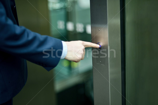 Hand pressing elevator button Stock photo © stockyimages