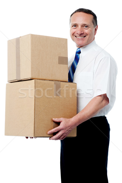 Stock photo: Business executive holding a boxes