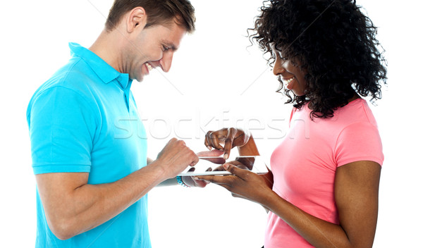 Couple using wireless touch pad device Stock photo © stockyimages
