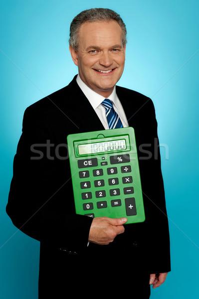 ストックフォト: シニア · 執行 · ポーズ · ビッグ · 緑 · 電卓