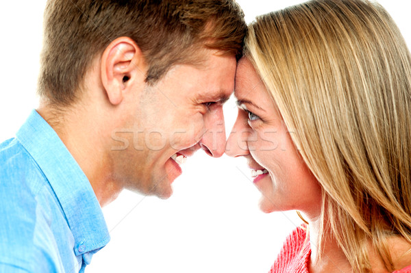 Souriant couple posant toucher isolé blanche Photo stock © stockyimages