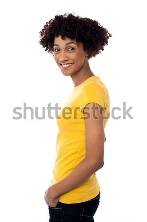 Сток-фото: красивая · женщина · желтый · Top · джинсов · очаровательный