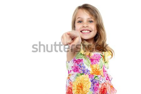 Cute girl kid pointing at you Stock photo © stockyimages