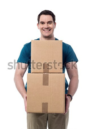 Man carrying couple of cardboard boxes Stock photo © stockyimages