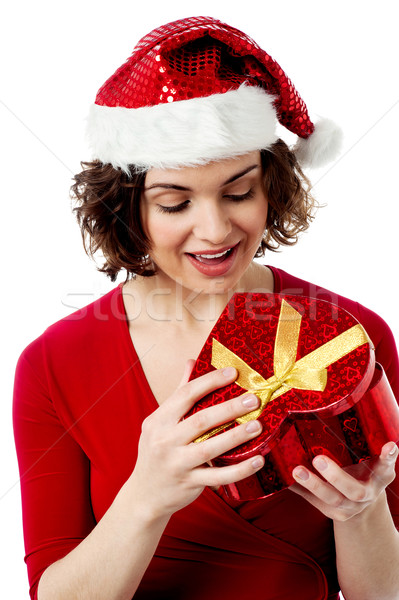 Pretty santa opening the gift box Stock photo © stockyimages