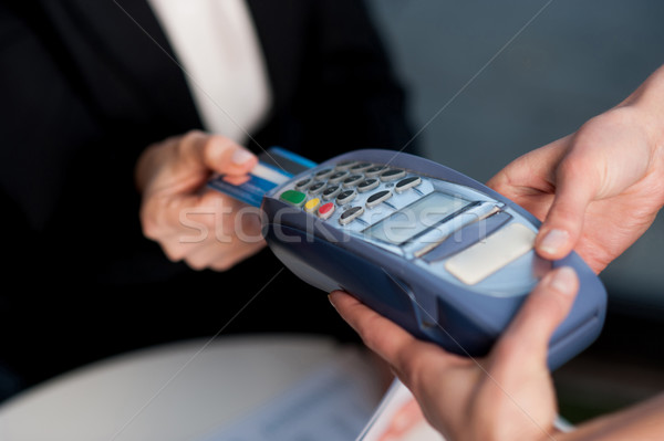 Corporate lady swiping her card to pay Stock photo © stockyimages