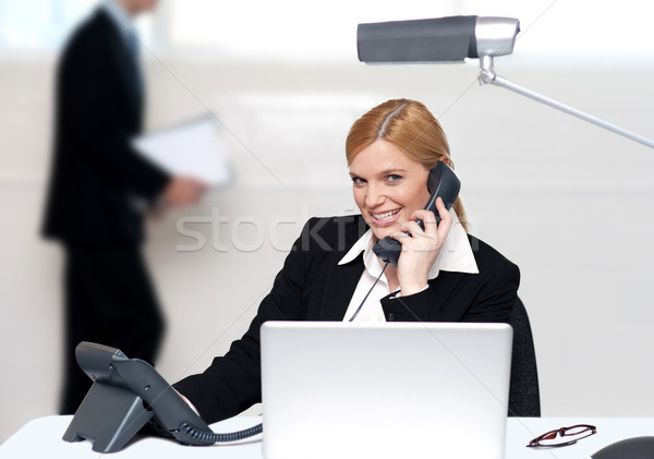 Attractive secretary attending phone call Stock photo © stockyimages